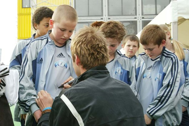 14 March 2005, The David Beckham Academy Launch, The Chainstore, London Current Tottenham Hotspur player Harry Kane (boy with shaved head) meets David Beckham. Picture: Mooneyphoto
